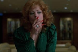 Film still from 'Black Widow.' Theresa Russell smoking a cigarette.