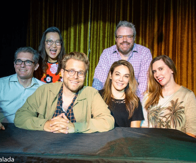 A photograph taken at the live recording of the episode, including Jeff Ryan, Helen Hong, Adam Conover, J. Keith van Straaten, Jill-Michele Melean, Shauna Cross