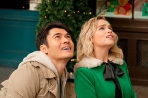A still of Henry Golding and Emila Clarke from 'Last Christmas' staring up into the sky