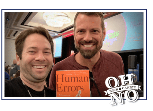 Ross and Nathan Lents standing together holding a copy of Human Errors