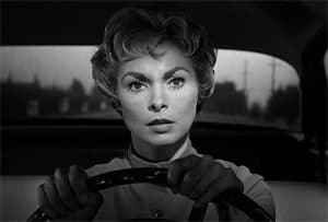 Janet Leigh in a film still from 'Psycho' driving her car, staring right into the camera