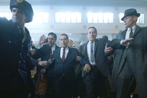 A still from 'The Irishman.' Robert De Niro and Al Pacino are being led out of a courtroom.