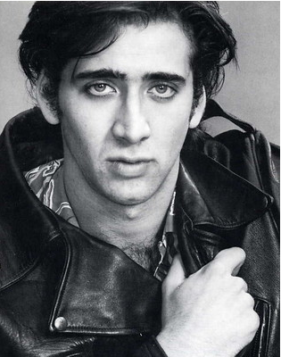 a black and white photo of young Nicolas Cage