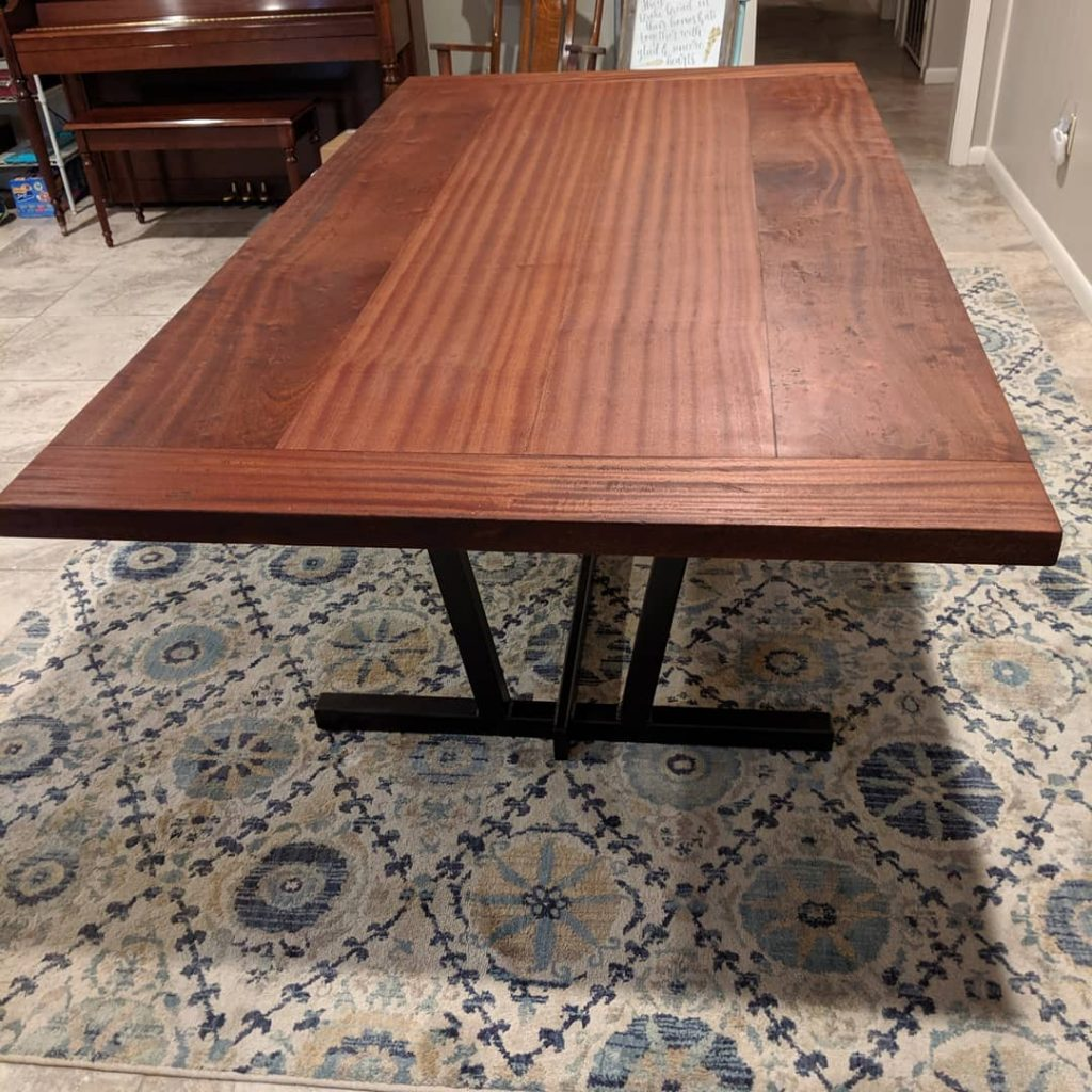 a mahogany wood dining table