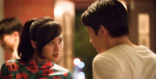 Hong-Chi Lee and Yo-Hsing Fang in the film 'Tigertail' (2020). They stare at each other lovingly