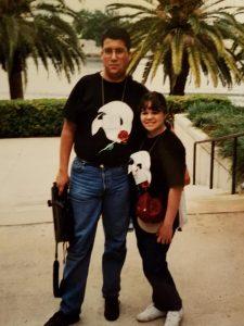 Dan and Lana wearing matching Phantom of the Opera shirts at age 16