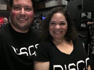 Dan and Lana wearing matching shirts that say DISCO