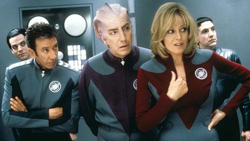A still from 'Galaxy Quest' (1999). Tim Allen, Alan Rickman, and Sigourney Weaver wearing Star Trek-like costumes.