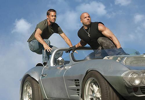 A still from 'Fast Five' (2011) Paul Walker and Vin Diesel surf a car that flies through the air