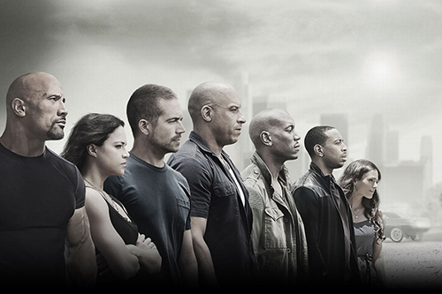 The poster from 'Furious 7' (2015). The whole crew stares off in one direction