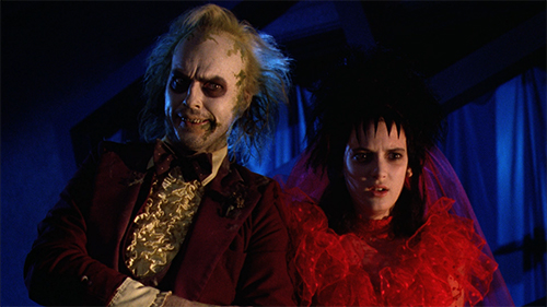 Film still from 'Beetlejuice' (1988). Michael Keaton and Winona Ryder in disturbing wedding outfits
