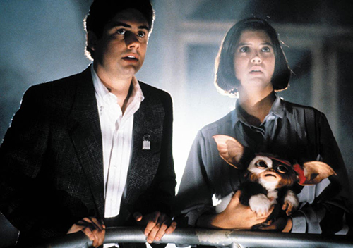 A film still from 'Gremlins 2: The New Batch' (1990). Zach Galligan, Phoebe Cates, and Gizmo