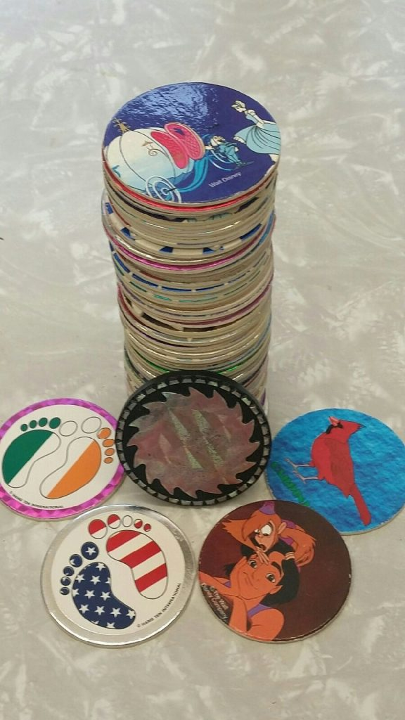 a stack of pogs, with some loose