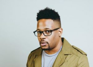 Mike Eagle today in a green jacket and grey shirt.