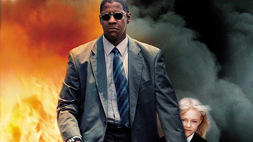 The poster of 'Man on Fire' (2004). Denzel Washington walks away from an explosion calmly, protecting Dakota Fanning from the blast.