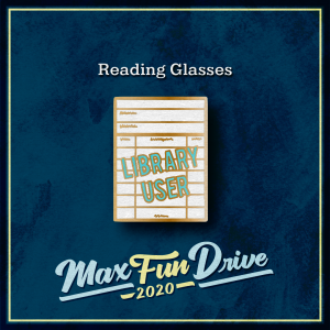 """Reading Glasses. A white library checkout card with gold lines and the words """"LIBRARY USER"""" in light blue on top of it."""