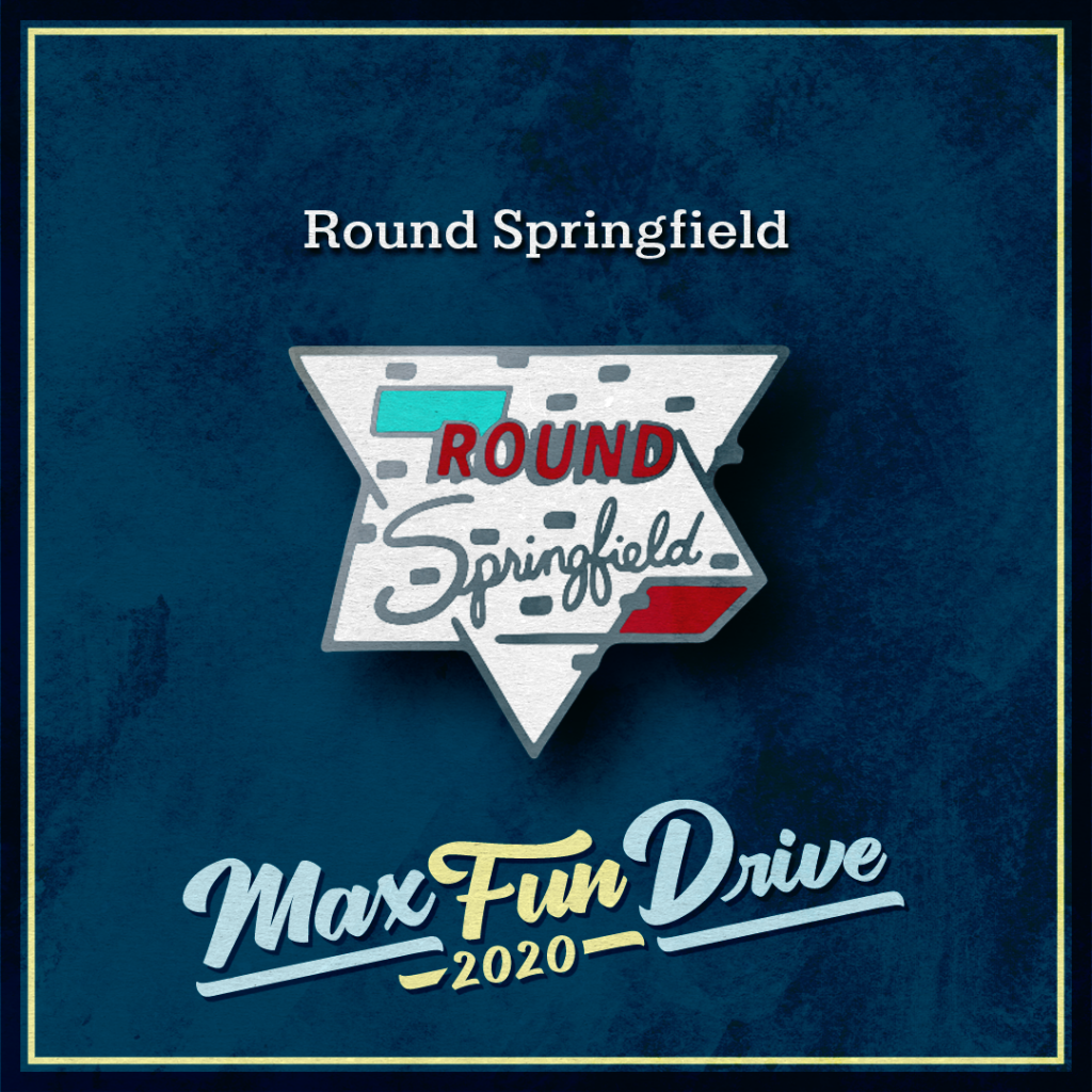 """Round Springfield. A retro-looking white sign with the words """"ROUND Springfield"""". """"ROUND"""" is written in bold red text and """"Springfield"""" is written in silver cursive."""