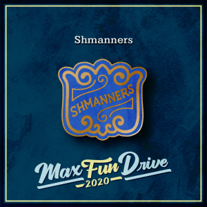 """Shmanners. A gold and blue pin with a curling gold filigree border and the word """"SHMANNERS"""" in gold."""
