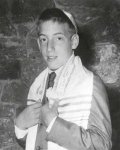 Teen Alan Zweibel in a black and white photo wearing a yamaka