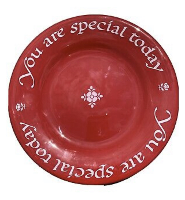 a red plate that says
