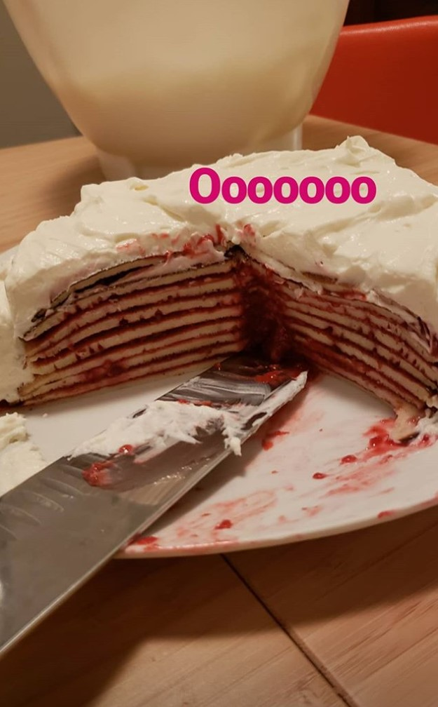 a crepe cake with a few slices cut out of it and the caption