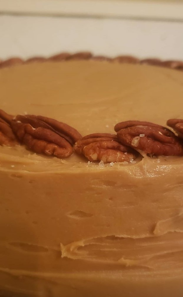 cake with icing and pecans around perimeter