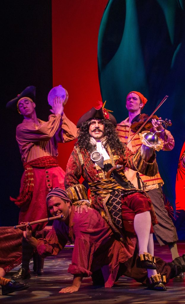 A still from a Peter Pan performance, showing Captain Hook and his crew
