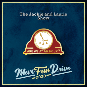 """The Jackie and Laurie Show. An old-fashioned red clock with the words """"ARE WE AT AN HOUR?"""" in gold under a white clock face that contains the letters """"J & L"""" in gold under the hands of the clock."""
