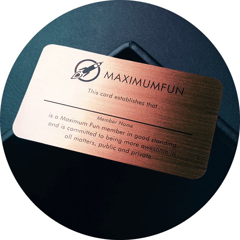 A bronze card etched with the MaxFun Logo and text.