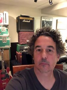 Tim Parnin in front of his amp collection