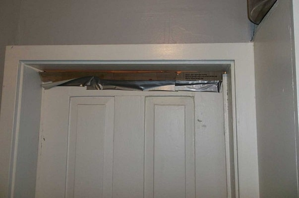 duct tape across the top of a door