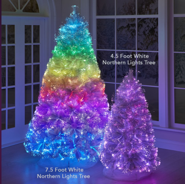 a large rainbow christmas tree with a small pink christmas tree next to it