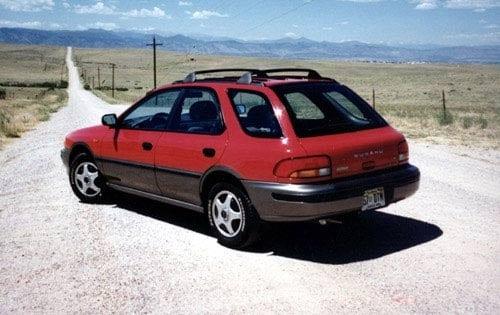 The back angle of a red Subaru Impreza wagon