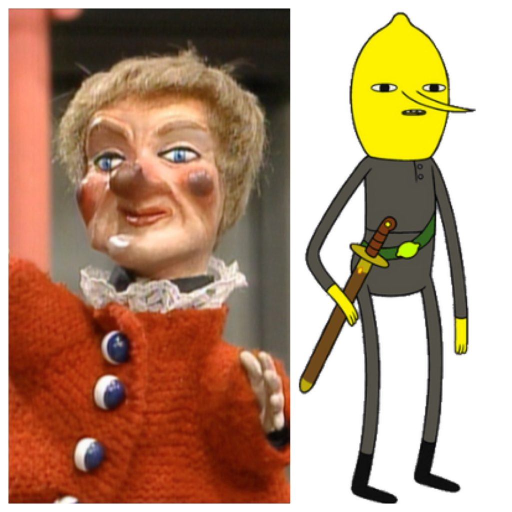 An old woman puppet side by side with a cartoon drawing of a person with a lemon head
