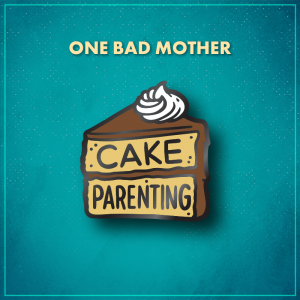 """One Bad Mother. A slice of yellow layer cake with brown frosting and a swirl of white whipped cream on top. The top layer of the cake says """"Cake"""" and the bottom says """"Parenting."""""""