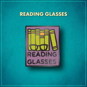 """Reading Glasses. A purple rectangle with five green books standing straight on a shelf with a sixth green book to the right that is leaning on the book to its left. Black glasses sit in front of the books and words """"Reading Glasses"""" are in black on the bottom of the pin."""