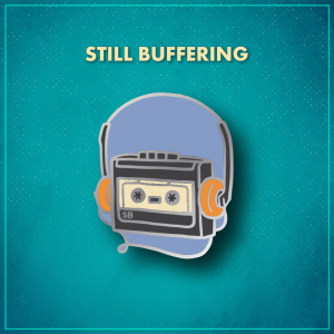 """Still Buffering. A grey cassette player on a periwinkle background with the letters """"SB"""" in the lower left corner. The player is wearing headphones with orange padding on the ears and houses an off-white cassette."""