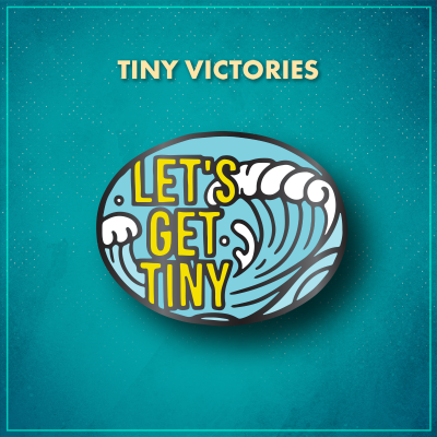 "Tiny Victories. Tall, bold yellow text reads ""Let's Get Tiny."" Behind it is a light blue ocean wave topped with white foam, set against a blue sky."