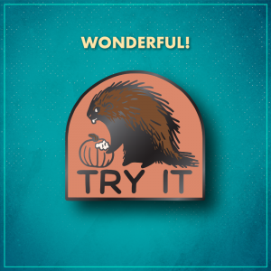 """Wonderful! An arched rust-colored background with a brown porcupine looking to the side while their front foot is on a pumpkin with bite marks taken out of it. The bottom reads """"Try it"""" in black letters."""