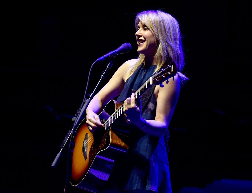 Liz Phair playing the guitar