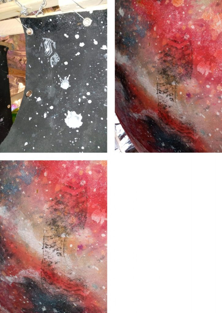 Close up photos of the space themed panels, showing painted shoe prints on them.